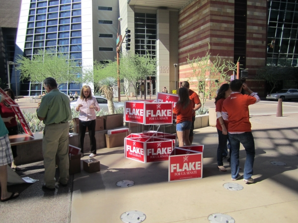 Volunteers assemble signs supporting Jeff Flake